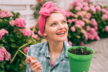 Flower care and watering. soils and fertilizers. hydrangea. Spring and summer. Greenhouse flowers. happy woman gardener with flowers. woman care of flowers in garden. Exhausted woman