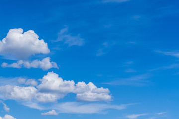 Clear blue sky, with white clouds as background.