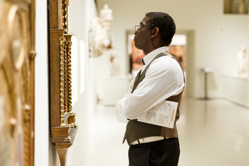 African man looking at exhibit