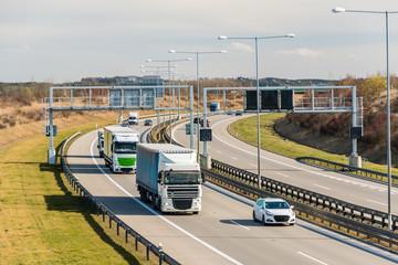 Lorry and car passing toll gate on Prague Circuit, Prague, Czech republic