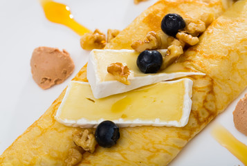 Delicious pancakes with cheese Brie, walnuts and foie gras
