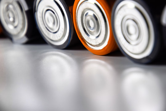 Salt and alkaline batteries, source of energy for portable technology. AAA and AA batteries
