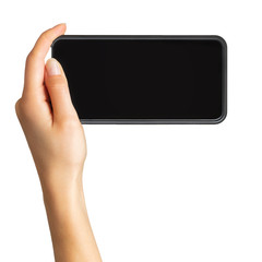 Women's hand showing black smartphone, concept of taking photo