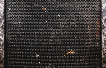 frontal close up image of speakers grill. Musical instruments and sound equipment background