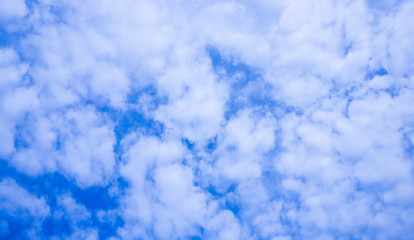 Vast blue sky with white clouds. Cloudscape abstract texture pattern background. Heaven concept. Nature landscape. Anime clean style. Plain landscape background for summer poster. Dramatic sky, clouds