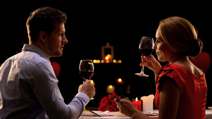 Male and lady having dinner in restaurant tasting red wine, couple on blind date