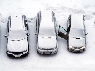 Ground parking cars after snowfall