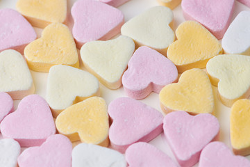 pastel colored candy hearts, macro photo as background picture
