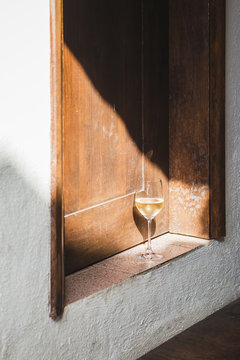 glass of wine in a ray of light