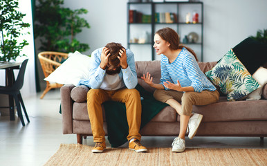 family couple quarrels in a conflict at home