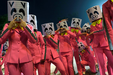 Performers wear pig masks as they take part in a Lunar New Year night parade in Hong Kong