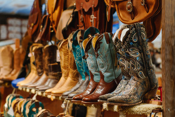 Stylish western boots on a shelf in a store