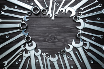 wrenches and heart on dark wooden background. Concept love for their work.