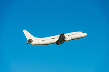 Aircraft without liveries against the blue sky. Airplane travel concept