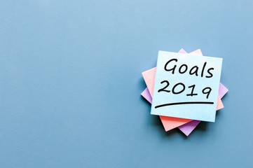 2019 goals on blue background. Goal, dreams and New Year's promises for the next year