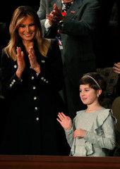First Lady Melania Trump applauds young cancer survivor Grace Eline during U.S. President Donald Trump's State of the Union address to a joint session of Congress on Capitol Hill in Washington