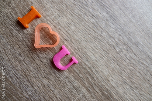 i love u' word Close-up shot selective focus colorful, magnetic