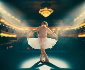 girl dreaming of becoming a ballerina