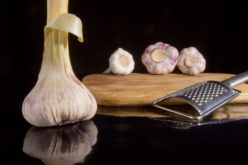 Heads of garlic and grater