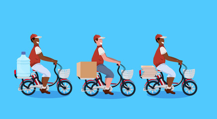 mix race couriers men cycling bicycle carrying parcel box water bottle pizza express delivery concept guys in uniform riding bike male cartoon characters full length horizontal flat