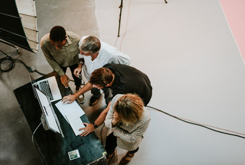 Wall Mural - Behind the scenes with a shoot team