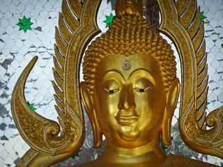 Buddha statue in thailand. Face close up.