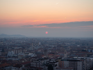 Bergamo, Italy. Landscape to the new city (downtown) at the sunrise from the old town located on the top of the hill
