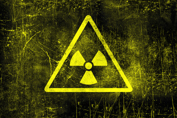 Nuclear radiation sign on old grungy wall. Symbol of radiation contamination. Monochrome yellow black illustration