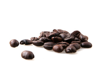 Wall Mural - Roasted Coffee Beans Over White Background