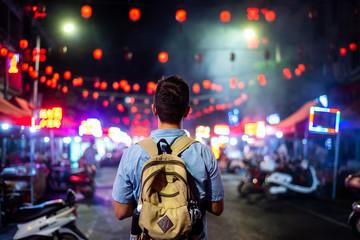 Traveler exploring Asian food market street