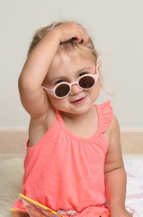 girl in pink with glasses