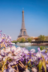 Wall Mural - Eiffel Tower with boats during spring time in Paris, France