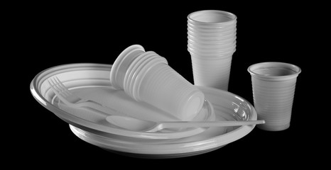 Disposable white plastic plate with cups, spoon and fork clipping path, isolated on black background