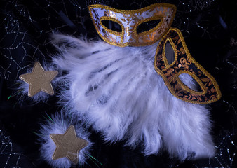 white and black carnival masks with feathers stars and sparkles