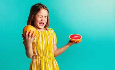 Girl does not like the taste of grapefruit