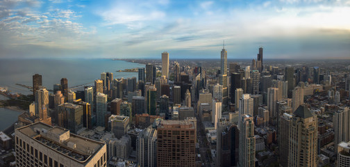 Fototapete - Chicago skyline panorama aerial view with skyscrapers and cloudy sky at sunset.