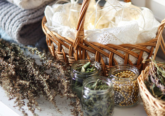 Medicinal herbs and other trinkets in jars and baskets