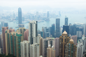 Panorama Hong Kong city view from Victoria peak. Business building and skyscrapers in Hong Kong city in Victoria harbour, China. Aerial view