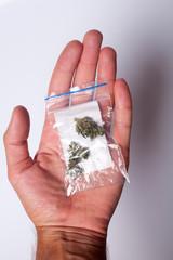 hand with pack of marijuana