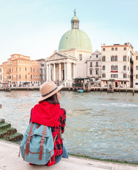 Happy asian woman travels in Venice. Great View on the famous tourist landmark Grand canal. Italy vacation concept