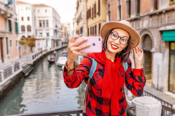 Happy asian woman taking selfie in Venice. Travel vacation in Italy and Europe concept