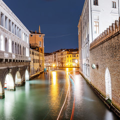 Narrow canal street at Early evening blue hour in Venice, Italy