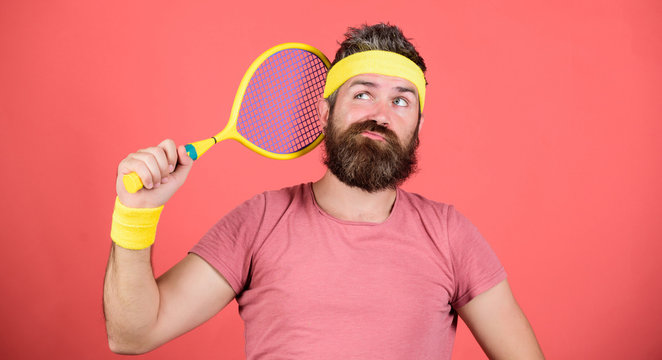 Tennis sport. Tennis club concept. Man bearded hipster wear old school sport outfit with bandages. Tennis can be an effective way to lose weight. Athlete hold tennis racket in hand on red background