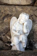 A white mourning porcelain angel at Mirogoj cemetery, Zagreb, Croatia