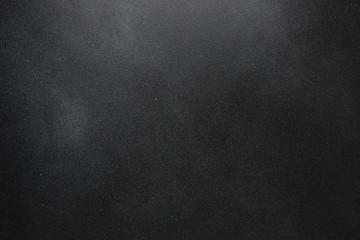 Dark cement background. Black texture wall with copyspace