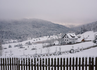 Fototapete - Snow falling on the countryside during winter