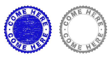 Grunge COME HERE stamp seals isolated on a white background. Rosette seals with grunge texture in blue and gray colors. Vector rubber stamp imitation of COME HERE title inside round rosette.