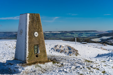 Trig Point at the summit of Cleeve Hill on the Cotswold Way, Gloucester UK in winter