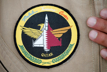 A military patch is worn by a Qatari Rafale jet fighter pilot during a ceremony at the factory of French aircraft manufacturer Dassault Aviation in Merignac