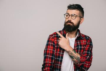 stylish bearded man pointing isolated on grey
